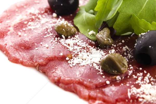 Beef carpaccio with rucola and parmesan  Stock photo © joannawnuk