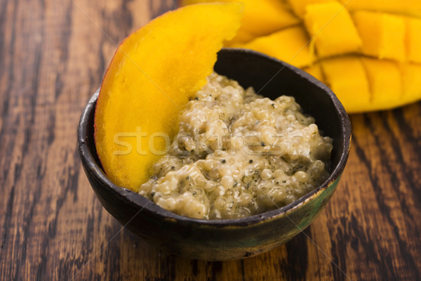 Tapioca pudding with slices of mango Stock photo © joannawnuk