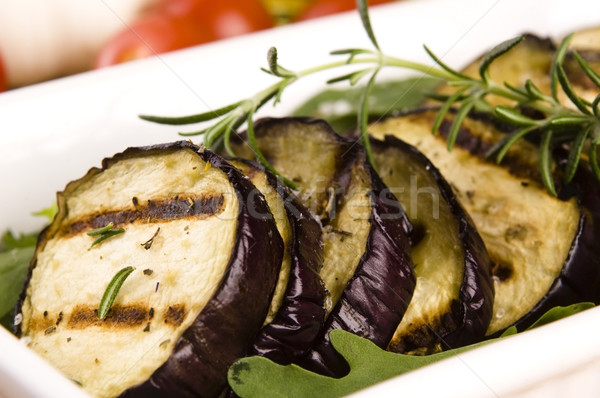 Grilled eggplant slices on a plate with fresh rosemary Stock photo © joannawnuk