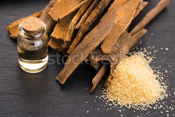 Cinnamon essential oil Stock photo © joannawnuk