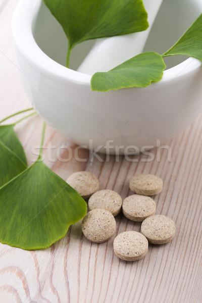 Ginkgo biloba leaves in mortar and pills Stock photo © joannawnuk