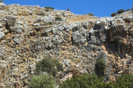 A rock wall against a blue sky Stock photo © joannawnuk