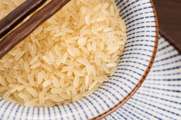 bowl of parboiled risotto rice Stock photo © joannawnuk