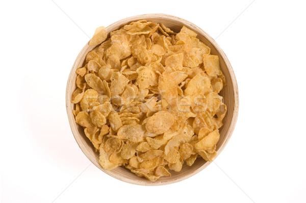 Snacks cornflakes kom geïsoleerd witte voedsel Stockfoto © joannawnuk