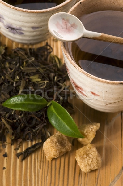 Groene thee blad thee goud beker japans Stockfoto © joannawnuk