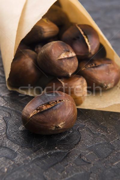 Delicious roasted chestnuts Stock photo © joannawnuk