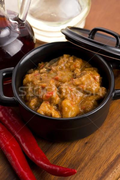 homemade hot goulash on wooden table Stock photo © joannawnuk