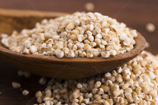 Barley groats on wooden spoon Stock photo © joannawnuk