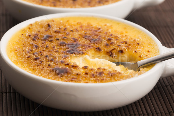 Creme brulee.French vanilla cream dessert with caramelised sugar Stock photo © joannawnuk