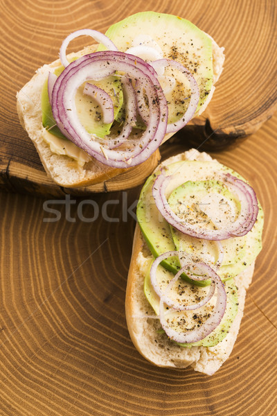 Sandwich with avocado, red onion, salt and herbs Stock photo © joannawnuk