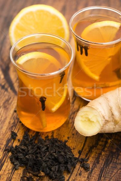 Zwarte thee citroen gember tabel beker Stockfoto © joannawnuk