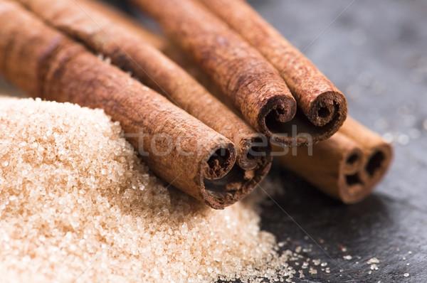 Aromás fűszer barnacukor fahéj háttér energia Stock fotó © joannawnuk