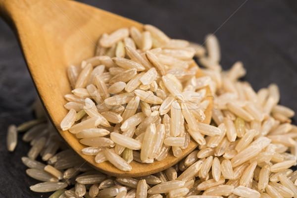 Spoon of brown rice close up Stock photo © joannawnuk
