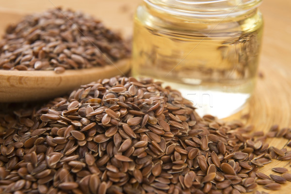 Linseed oil and flax seeds on wooden background  Stock photo © joannawnuk