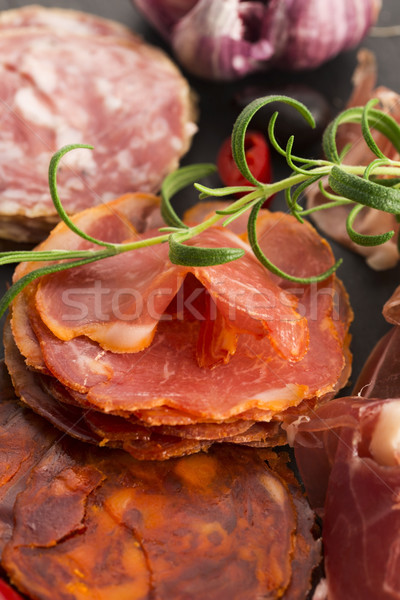 a pile of different spanish embutido, jamon, chorizo and lomo em Stock photo © joannawnuk