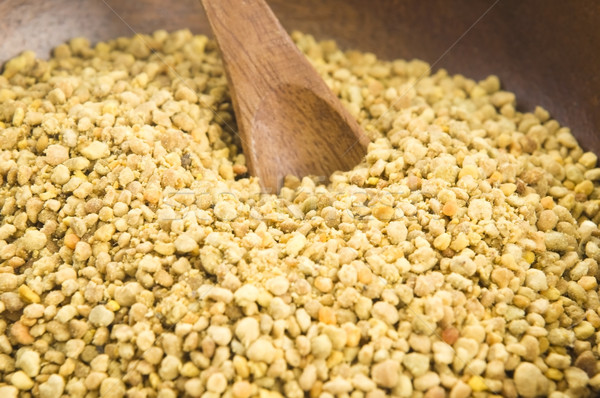 Bee pollen in wooden scoop. Nutritional supplement Stock photo © joannawnuk