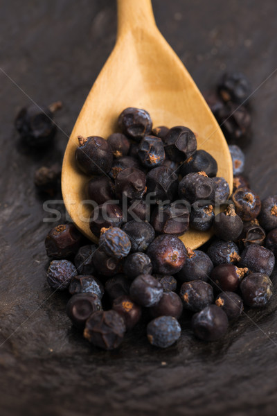 Juniper berries on a wooden background Stock photo © joannawnuk