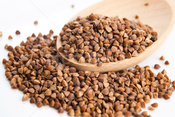 Buckwheat seeds on wooden spoon in closeup  Stock photo © joannawnuk