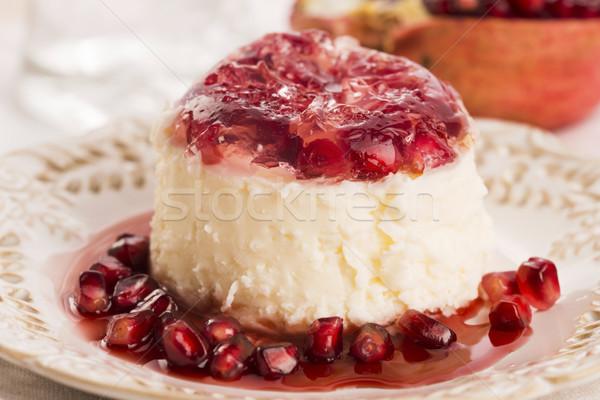 coconut panna cotta dessert with pomegranate Stock photo © joannawnuk