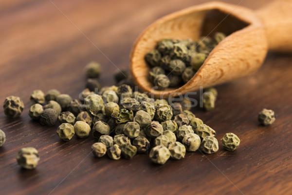 Green Peppercorns on wooden background Stock photo © joannawnuk