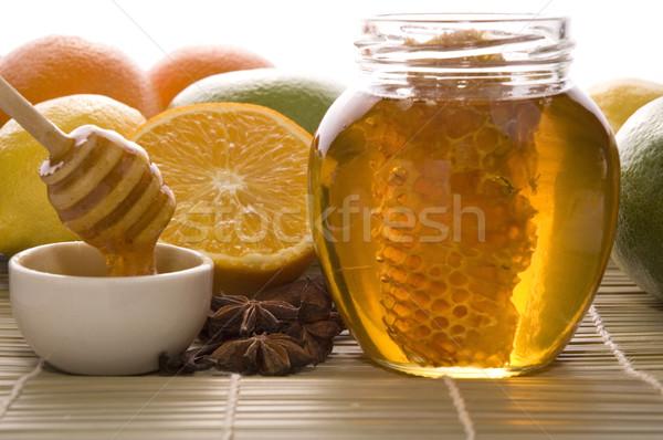 Friss méz méhsejt fűszer gyümölcsök citromok Stock fotó © joannawnuk