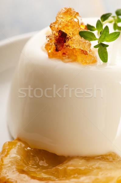 Vanilla Panna Cotta Dessert with lemon and fresh herbs Stock photo © joannawnuk
