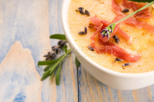 Stock photo: fresh melon soup with parma ham and lavender flower