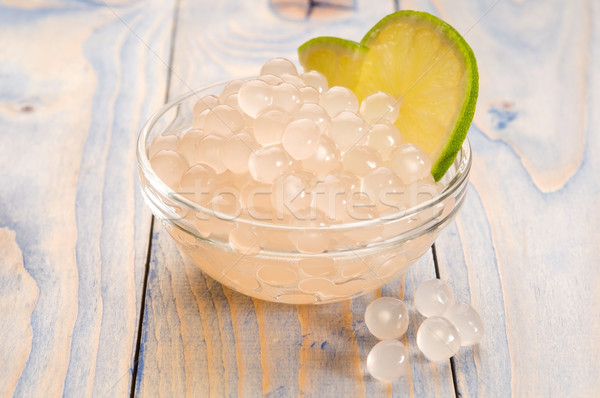 Stock photo: tapioca pearls with lime. white bubble tea ingredients