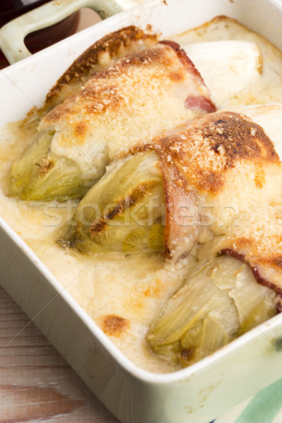 chicory baked with bacon and cheese  Stock photo © joannawnuk