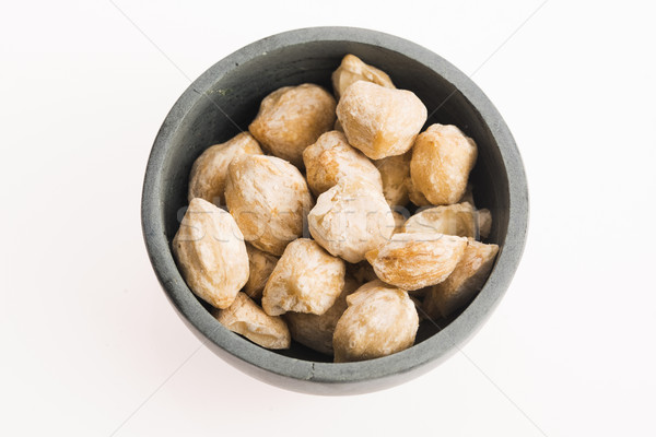 Candlenut or Kukui is a spice especially used in indonesian cook Stock photo © joannawnuk