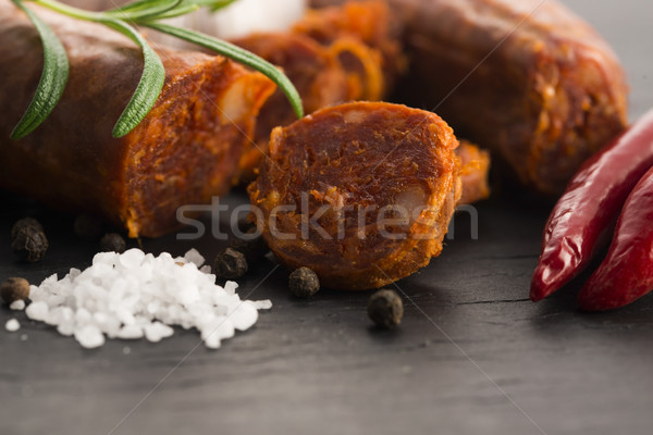 spanish traditional chorizo sausage, with fresh herbs Stock photo © joannawnuk