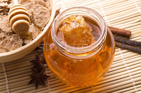 édes reggeli friss méz méhsejt pelyhek Stock fotó © joannawnuk