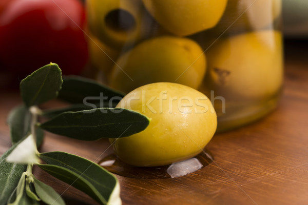 pickled olives and olive tree branch Stock photo © joannawnuk