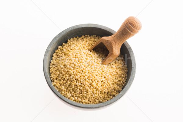 millet groats on white Stock photo © joannawnuk