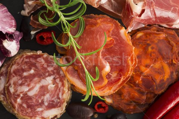 a pile of different spanish embutido, jamon, chorizo and lomo em Stock photo © joannawnuk