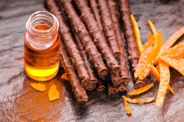 chocolate sticks with orange Stock photo © joannawnuk