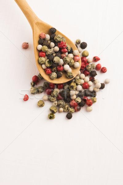Mixed green, red, white and black peppercorns Stock photo © joannawnuk