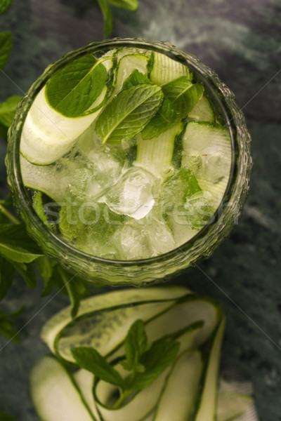 Refreshing detox cocktail with cucumber, mint and ice in glass Stock photo © joannawnuk
