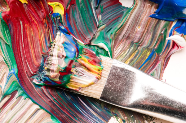 Brush mixing paint on palette Stock photo © joannawnuk
