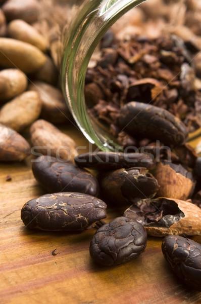 какао бобов природного деревянный стол шоколадом кухне Сток-фото © joannawnuk