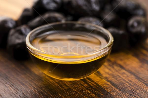 Close up of black olives and olive oil Stock photo © joannawnuk