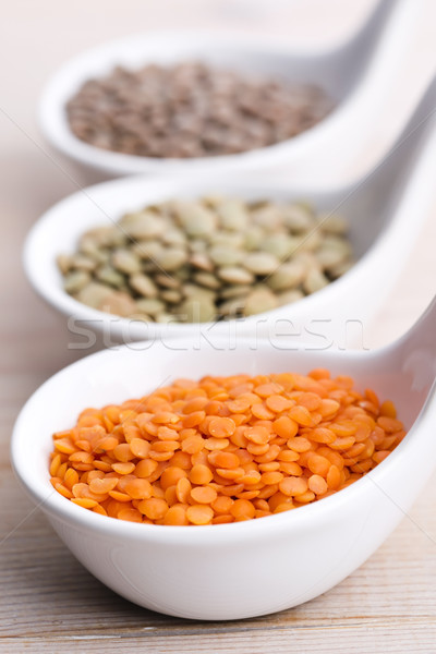 Three kinds of lentil in bowls - red lentil, green lentil and br Stock photo © joannawnuk