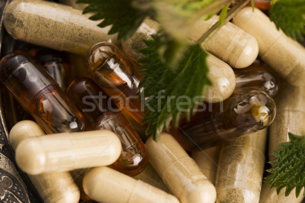 pills with herbs, macro Stock photo © joannawnuk