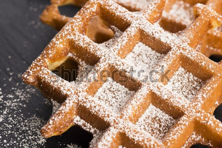 fresh waffles garnished with powdered sugar and raspberries  Stock photo © joannawnuk