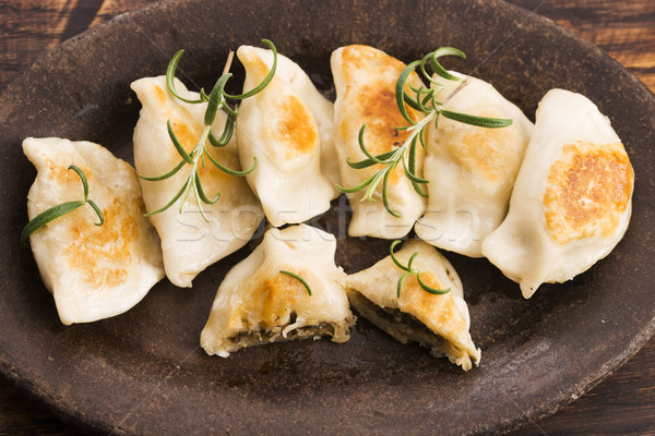 Polish pierogi filled with cabbage and mushrooms Stock photo © joannawnuk