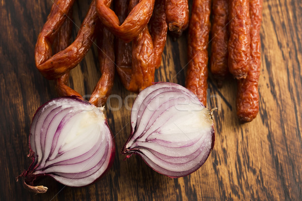 Snack stick sausage with onion Stock photo © joannawnuk
