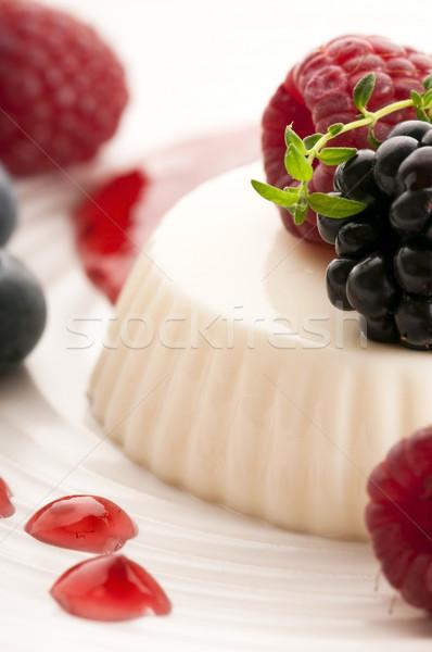 Stock photo: Vanilla panna cotta with berry sauce