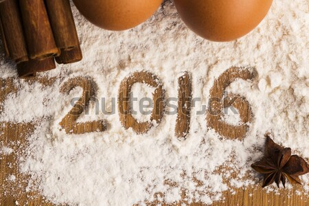 The word sugar written into a pile of white granulated sugar Stock photo © joannawnuk