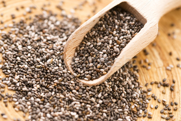 Nutritious chia seeds on a wooden spoon Stock photo © joannawnuk