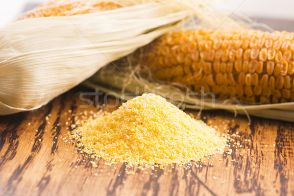 Corn groats and seeds, corncobs on wooden rustic table Stock photo © joannawnuk